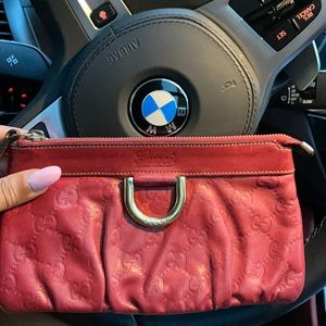 Authentic red leather Guccicisma wristlet.
